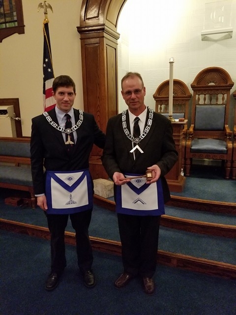 Past Master Jubinville presents current Master Ferguson a customized gavel